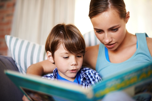 Helping her son with his reading
